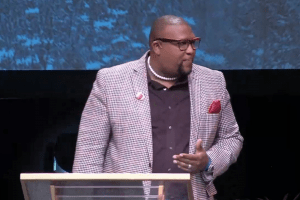 Pastor Dr. David Anderson wears EMBRACE Microphone