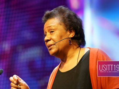 USITT 2019 Keynote speaker Jackie Taylor wears the CO2 Confidence headset microphone